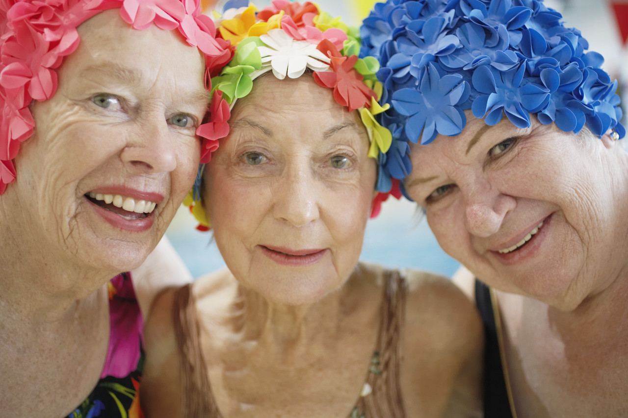 Women Wearing Colorful Bathing Caps --- Image by © Royalty-Free/Corbis