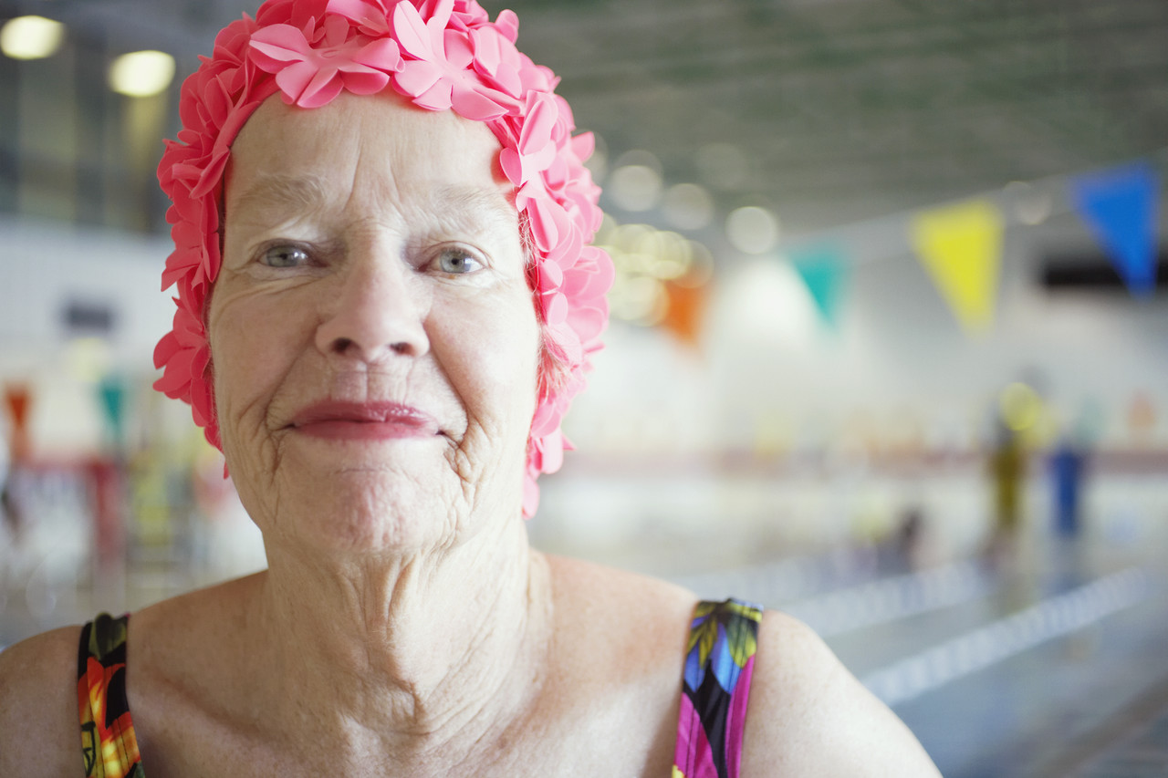 Woman in Colorful Bathing Cap --- Image by © Royalty-Free/Corbis